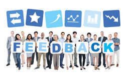 Business People Holding Word Feedback Stock Photography