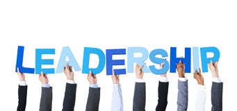 Business People Holding the Word Leadership. Business People Arms Raised and Holding the Word Leadership Stock Photos