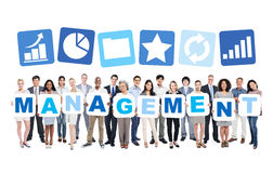 Business People Holding The Word Management Stock Images