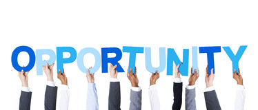 Business People Holding the Word Opportunity Royalty Free Stock Photography