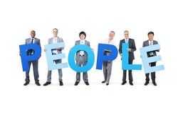 Business People Holding the Word People.  royalty free stock photos