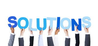 Business People Holding the Word Solutions Stock Photo
