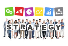 Business People Holding The Word Strategy Royalty Free Stock Photography