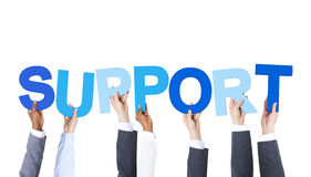 Business People Holding the Word Support. Business People Arms Raised and Holding the Word Support royalty free stock photos