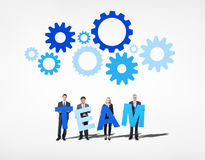 Business People Holding Word Team.  royalty free stock image