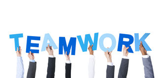 Business People Holding the Word Teamwork Royalty Free Stock Images