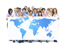 Business People Holding World Map Stock Photo