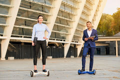 Business people on hoverboards. stock photo