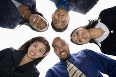 Business people in huddle Royalty Free Stock Photos