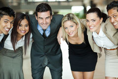 Business people huddling Stock Images