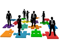 Business people human resources team puzzle. Human resources issues and other people issues and solutions with people on jigsaw pieces, which actually form a Royalty Free Stock Photography
