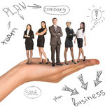 Business people in humans hand on white Royalty Free Stock Images