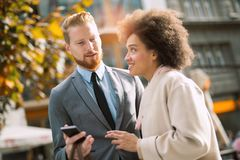 Business people in an informal conversation Stock Photo