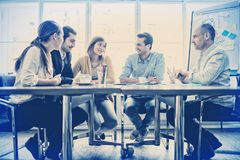 Business people interacting with each other. In office royalty free stock photo