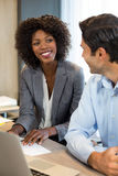 Business people interacting with each other. Smiling business people interacting with each other in office Royalty Free Stock Photography