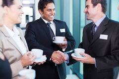 Business people interacting. Friendly business people interacting during conference break Royalty Free Stock Images