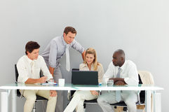 Business people interacting in a meeting. Young business people interacting in a meeting Royalty Free Stock Image