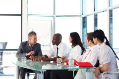 Business people interacting in a meeting Stock Photos