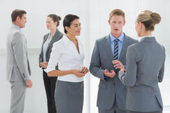 Business people interacting. In the meeting room Royalty Free Stock Photo