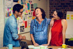 Business people interacting in office Stock Photo