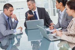 Business people interacting and working together. In bright office Royalty Free Stock Photo