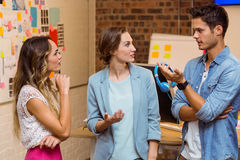Business people interacting at workplace Stock Image