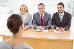 Business people interviewing woman Royalty Free Stock Images