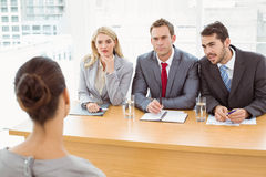 Business people interviewing woman Royalty Free Stock Photo