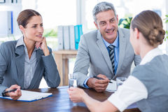 Business people interviewing young businesswoman Royalty Free Stock Image