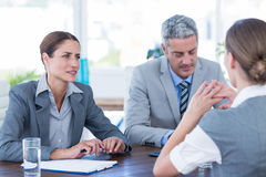 Business people interviewing young businesswoman Royalty Free Stock Images