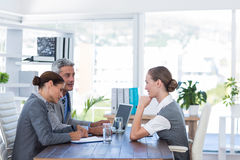 Business people interviewing young businesswoman Stock Photos