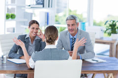 Business people interviewing young businesswoman Stock Photo