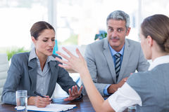 Business people interviewing young businesswoman Stock Photography