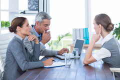 Business people interviewing young businesswoman Stock Image