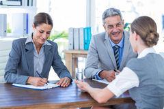 Business people interviewing young businesswoman Royalty Free Stock Photography