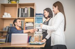 Business people introduction handshake with partner. Business people with introduction handshake with partner royalty free stock photos
