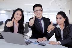 Business people from Japan and India showing thumbs up stock image