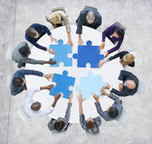 Business People and Jigsaw Puzzle Pieces.  Royalty Free Stock Photography