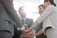 Business people join hand together during their meeting Stock Photos