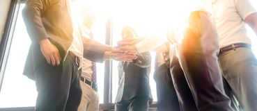 Business people join hand together. During their meeting with sun rays aura background Royalty Free Stock Photography