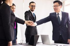 Business people join hands success for dealing in office,Team work to achieve goals,Hand coordination. Business people join hands success for dealing in office royalty free stock photo