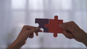 Business people join puzzle pieces in office. Concept of teamwork and partnership stock footage