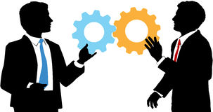 Business people join tech collaboration solution. Two business people work together to connect gear symbols of tech solution deal Stock Photography