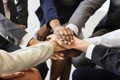 Business people joined hands together as teamwork Stock Photos