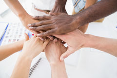 Business people joining hands in a circle Royalty Free Stock Images