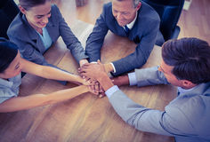 Business people joining hands in a circle Royalty Free Stock Photo