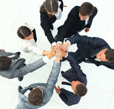 Business people joining hands in a circle in the office Royalty Free Stock Photography