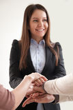 Business people joining hands, female executive unites employees. Growing great team spirit for small business, psychologist holding hands of reconciled family Royalty Free Stock Images