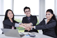 Business people joining hands in the office Royalty Free Stock Photo