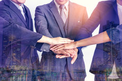 Business people joining hands together, success and team work co Stock Photos